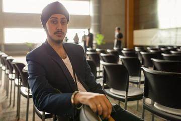 Portrait confident businessman in conference audience
