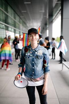 Portrait of gay pride activist with megaphone smiling