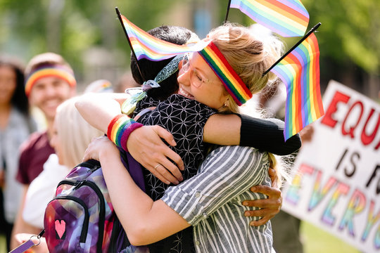 Couple embracing at gay pride festival
