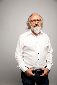 Portrait confident, handsome senior man with eyeglasses and gray beard