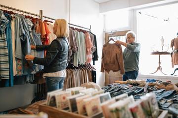 Senior couple clothes shopping
