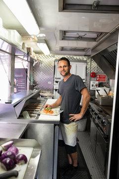 Portrait confident Food truck business owner preparing Food