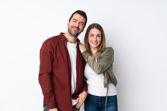 Couple in Valentine Day over isolated background laughing