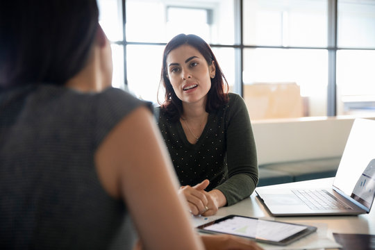 Businesswomen in meeting with laptop in office
