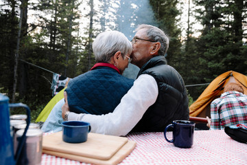Affectionate senior couple at campsite