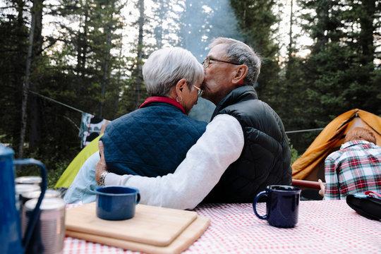 Affectionate senior couple at campsite