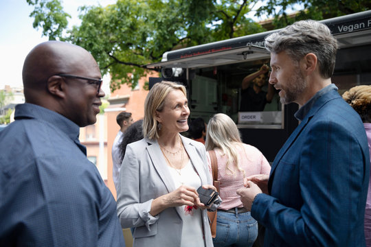 Business people talking outside Food truck