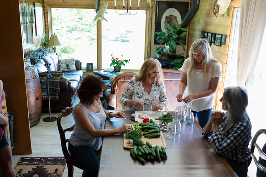Women making homemade pickles at home