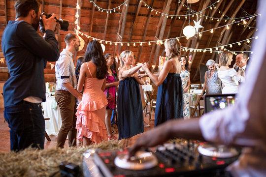 Happy bridesmaids dancing at wedding reception