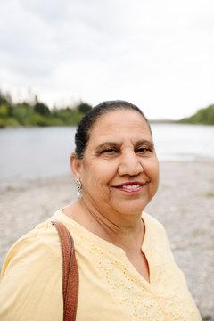 Portrait of senior Indian woman on lake shore