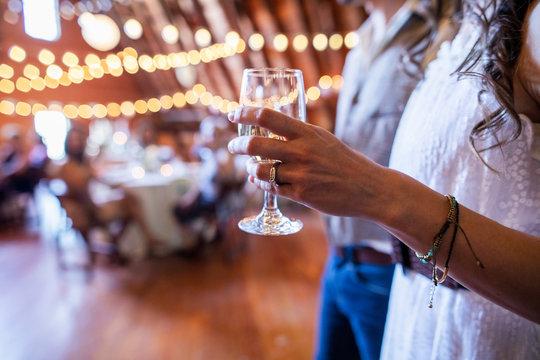 Close up bride drinking wine at wedding reception