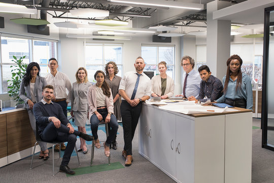 Portrait of diverse group of office colleagues looking at camera