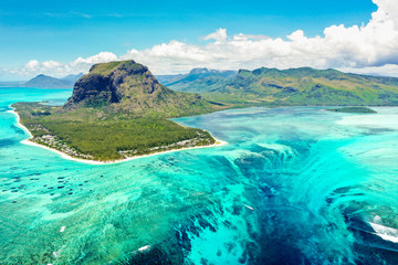 Fotobehang Luchtfoto Aerial panoramic view of Mauritius island - Detail of Le Morne Brabant mountain with underwater waterfall perspective optic illusion - Wanderlust and travel concept with nature wonders on vivid filter
