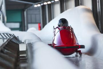 Foto op Plexiglas Wintersporten bob sled speeding in an ice channel