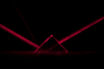 Mysterious red laser prism refracting from dark triangle