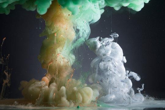 Creative green, orange and white liquid blending