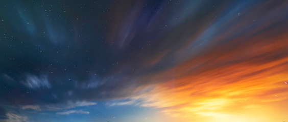 Long exposure clouds at the starry sky. Bright moon light behind the colorful clouds. Night photography. Astronomical background.