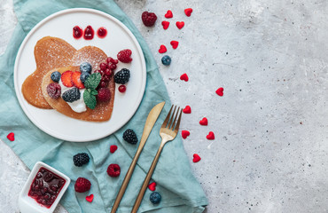 Romantic Breakfast on Valentine's Day of pancake heart shape, top views, flat lay