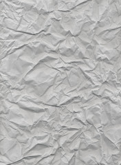 A texture of creased gray paper. A high resolution image. Can be used as a background for text.