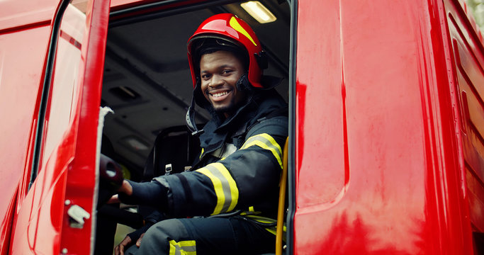 Firefighter portrait on duty. Portrait of african american Firefighter in protective suit.