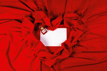 valentine card composition on a red fabric. there is always some madness in love let me be yours message.