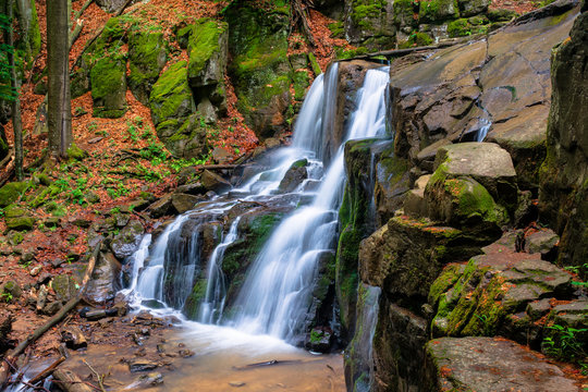 waterfall skakalo in the forests of transcarpathia. rapid water stream runs down the huge boulders. clear water of carpathian nature in springtime. long exposure