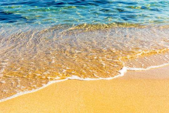 sea scenery in summer. beach with golden sand. wonderful vacation background with transparent calm waves and blue sky