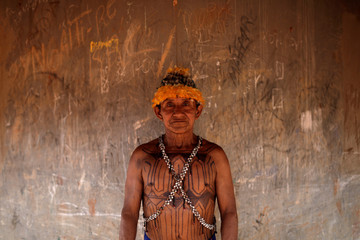 Geraldo, from Munduruku tribe poses for a picture during a four-day pow wow in Piaracu village, in Xingu Indigenous Park, near Sao Jose do Xingu