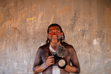 Kamikia, from Kisedje tribe poses for a picture during a four-day pow wow in Piaracu village, in Xingu Indigenous Park, near Sao Jose do Xingu