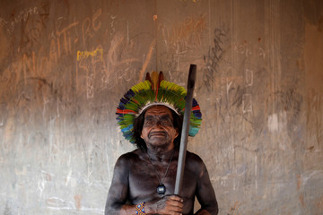 Pixara, from Yudja tribe poses for a picture during a four-day pow wow in Piaracu village, in Xingu Indigenous Park, near Sao Jose do Xingu