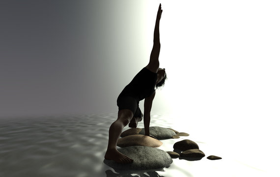 A man doing yoga on rocks in water