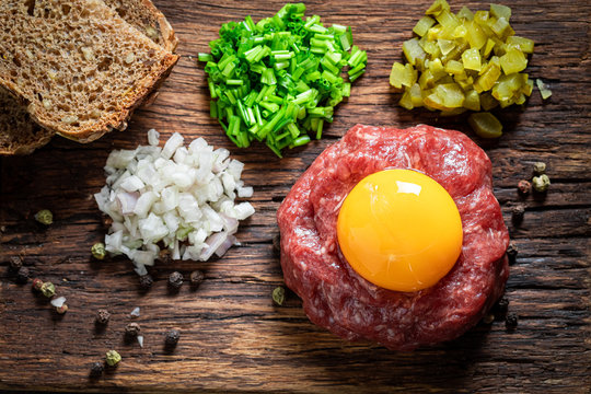 Enjoy your beef tartare with onion, cucumber and chives