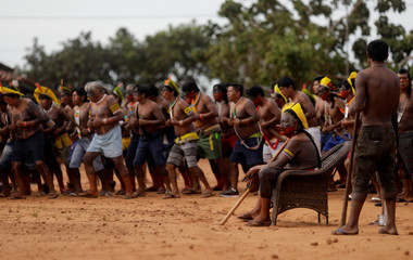 Indigenous leader Cacique Raoni of Kayapo tribe watches a performance of Kayapo people during a four-day pow wow near Sao Jose do Xingu