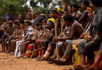 Indigenous leader Cacique Raoni of Kayapo tribe sits with others leaders during a four-day pow wow near Sao Jose do Xingu