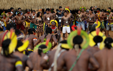 Indigenous leader Cacique Raoni of Kayapo tribe watches a performance of Kayapo people during a four-day pow wow near Sao Jose do Xingu,
