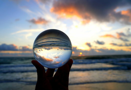Beautiful clouds during sunrise captured through a lens ball at Fort Lauderdale Beach, Florida, U.S.A