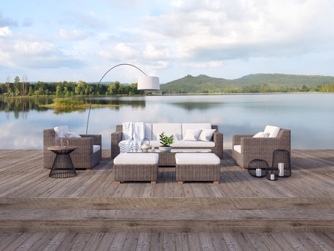 Outdoor terrace living area with beautiful lake and mountain view 3d render,There are old wood floor,Decorate with rattan furniture,Surrounded by nature