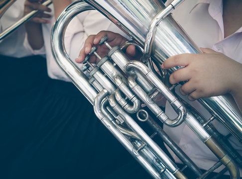 Close up of tuba musician, Presentation of the brass band. The instrument of the brass band tuba.