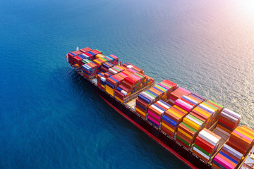Aerial view of container cargo ship in sea. Wall mural