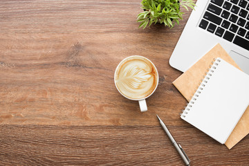 Wall Mural - cup of coffee on wooden table
