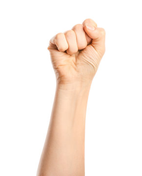 Hand of woman with clenched fist on white background