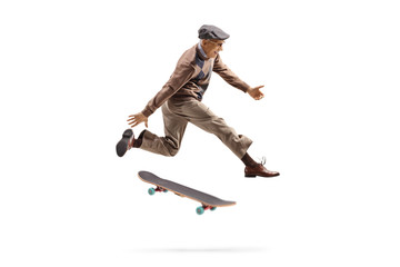Energetic elderly man jumping with a skateboard