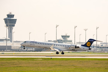 Plane from Lufthansa  ariline landing on the airport of Munich, Germany on April 9, 2017