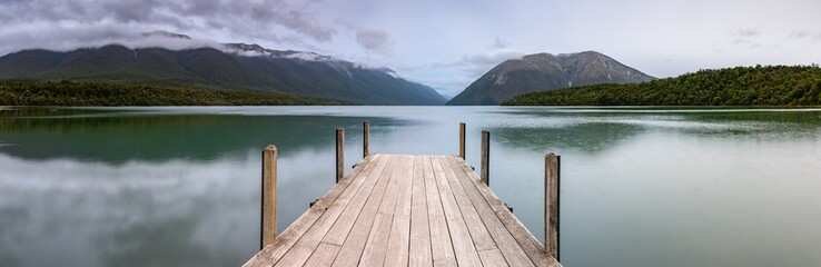 Poster Mountains Landscape photo of a jetty on Lake Rotoiti, New Zealand. This jetty is within the Nelson Lakes National Park and is one of the most Instagrammed locations in New Zealand