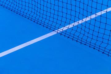 Fototapeta Blue tennis court surface, sport background..Detail of a tennis court.Tennis court with net background. obraz