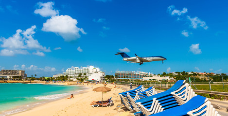 Landing of an airplane from Maho beach on the island of Saint Martin in the Caribbean