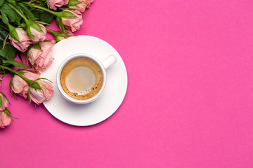 Pink roses, cup of coffee on pink background. Happy mother's day concept. Top view with copy space, 8 march Wall mural