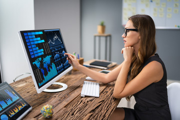 Businesswoman Analyzing Graph On Computer