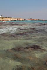 Rocky bottom on beach. Agia Napa, Cyprus