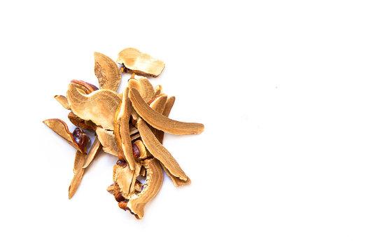 Pile of slice Lingzhi mushroom on white background (Ganoderma Lucidum). Chinese traditional medicine and nutritive value..
